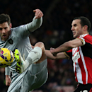 Burnley's Lukas Jutkiewicz, left, vies for the ball with Sunderland's captain John O'Shea, right, during their English Premier League soccer match between Sunderland and Burnley at the Stadium of Light, Sunderland, England, Saturday, Jan. 31, 2015