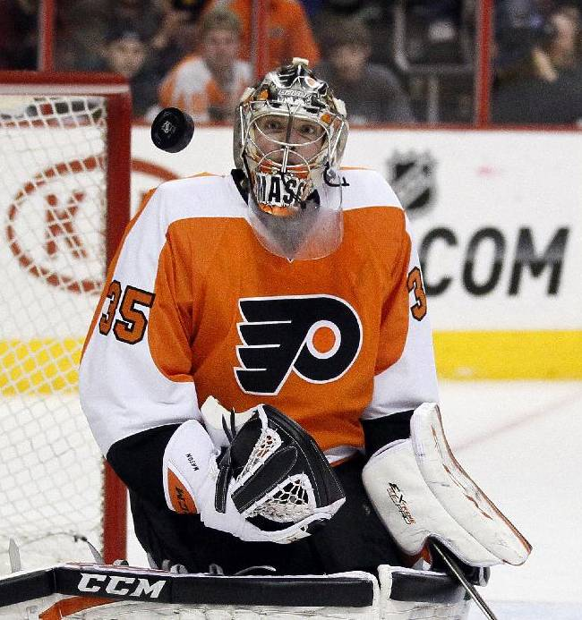 Philadelphia Flyers' Steve Mason watches the puck fly past during the first period of an NHL hockey game against the Buffalo Sabres, Sunday, April 6, 2014, in Philadelphia