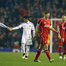 Liverpool's Steven Gerrard, second right, leaves the field at half time during the Champions League Group B soccer match between Liverpool and FC Basel at Anfield Stadium in Liverpool, England, Tuesday, Dec. 9, 2014