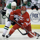 Carolina Hurricanes' Jeff Skinner (53) and Dallas Stars' Trevor Daley (6) chase the puck during the second period of an NHL hockey game in Raleigh, N.C., Thursday, April 3, 2014 The Associated Press