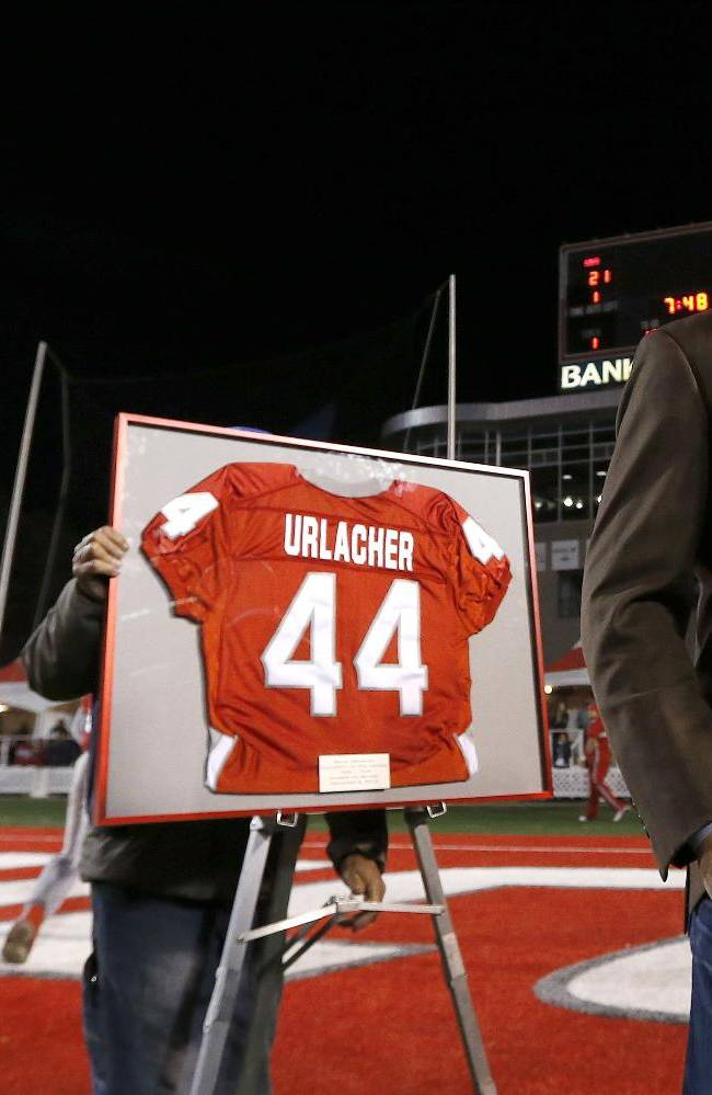 Former New Mexico and Chicago Bears football player Brian Urlacher pauses on the field as his jersey number is retired during a halftime ceremony at an NCAA college football game against the Air Force on Friday, Nov. 8, 2013, in Albuquerque, N.M