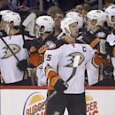 Anaheim Ducks' Ryan Getzlaf (15) celebrates with the bench after teammate Ryan Kesler scored during second-period NHL hockey action against the Wnnipeg Jets in Winnipeg, Manitoba, Sunday, Dec. 7, 2014 The Associated Press