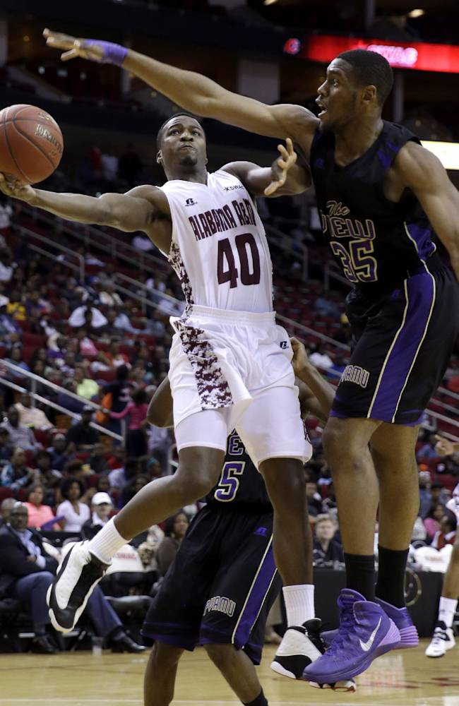 Alabama A&M's Brandon Ellis (40) goes up to shoot as Prairie View A&M's Reggis Onwukamuche (35) defends during the first half of an NCCA college basketball game in the semifinals of the Southwestern Athletic Conference tournament on Friday, March 14, 2014, in Houston