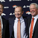 In this Jan. 14, 2011 file photo, John Fox, right, the then-new head football coach of the NFL team Denver Broncos, poses for a photo with owner Pat Bowlen , center, and John Elway, Executive V.P. of football operations, at the teams headquarters in Engl