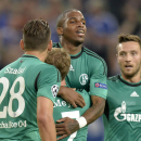 Schalke's Jefferson Farfan, center, celebrates after scoring the opening goal during the Champions League Qualification first leg soccer match between FC Schalke 04 and PAOK Saloniki in Gelsenkirchen, Germany, Wednesday, Aug. 21, 2013. (AP Photo/Martin Meissner)