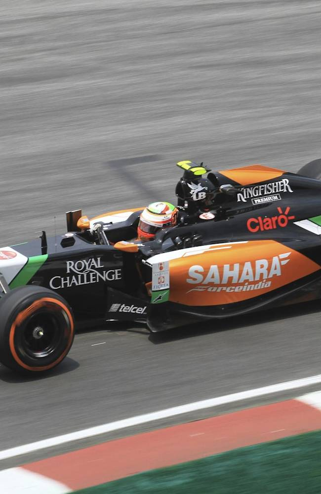Force India driver Sergio Perez of Mexico steers his car during the second practice session for the Malaysian Formula One Grand Prix at Sepang International Circuit in Sepang, Malaysia, Friday, March 28, 2014
