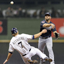 Milwaukee Brewers' Mark Reynolds is forced out at second as Atlanta Braves' Dan Uggla turns a double play during the second inning of a baseball game Tuesday, April 1, 2014, in Milwaukee The Associated Press