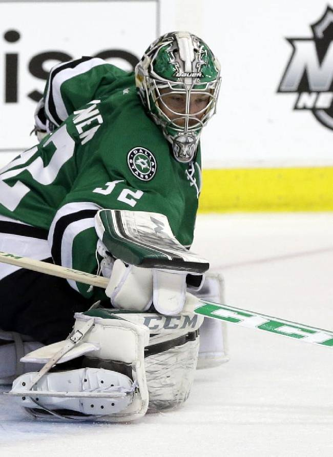 Dallas Stars goalie Kari Lehtonen (32) of Finland defends against a shot by the Anaheim Ducks in the second period of Game 3 of a first-round NHL hockey Stanley Cup playoff series game, Monday, April 21, 2014, in Dallas