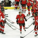 Daniel Alfredsson, center, of Sweden, is acknowledged by Ottawa Senators as he takes to the ice for the warmup skate before NHL action against the New York Islanders in Ottawa, Ontario, Thursday, Dec. 4, 2014. The 41-year-old, who signed a ceremonial one-