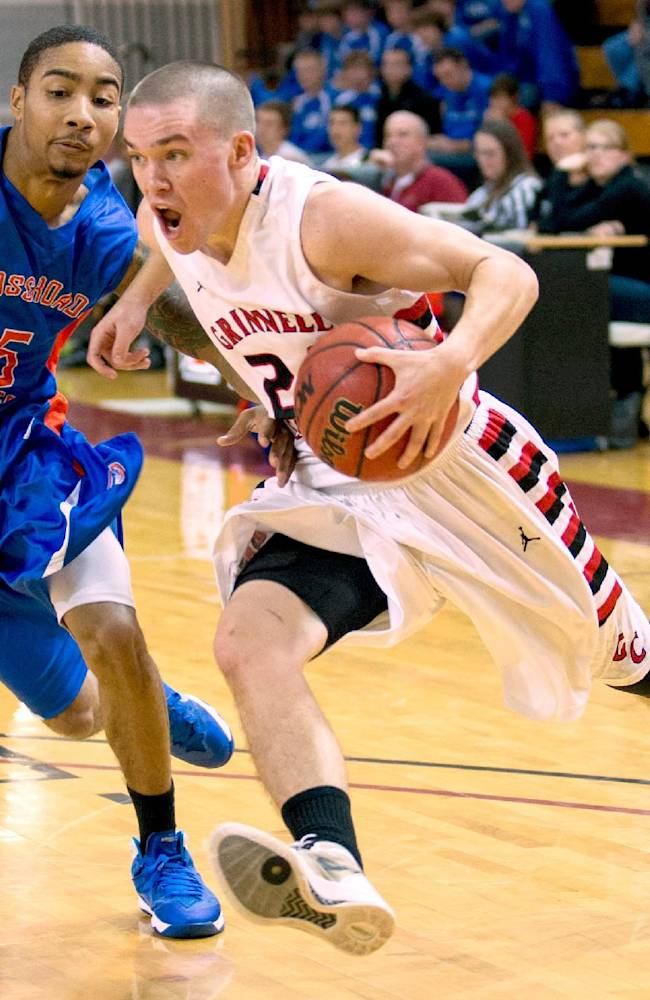 Grinnell College's Jack Taylor drives past Crossroads Brandon Jackson in the first half of their game in Grinnell Sunday afternoon. Taylor scored 109 points, including 24, 3-pointers leading Grinnell to a 173-123 victory over Crossroads. Taylor has scored 180 points in the first two games of the season