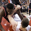Chicago Bulls' Nazr Mohammed, left, tangles with Toronto Raptors' Tyler Hansbrough after a loose ball foul during the first half of an NBA basketball game, Wednesday, Feb. 19, 2014 in Toronto The Associated Press