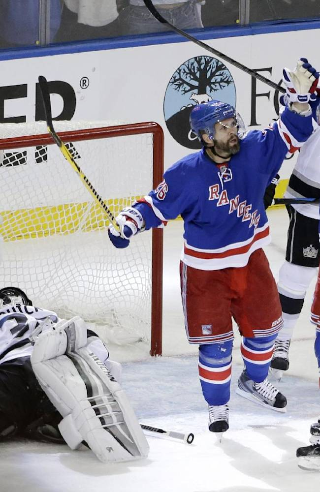 New York Rangers right wing Martin St. Louis (26) celebrates with left wing Chris Kreider (20) after scoring against Los Angeles Kings goalie Jonathan Quick (32) in the second period during Game 4 of the NHL hockey Stanley Cup Final, Wednesday, June 11, 2014, in New York
