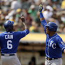 Kansas City Royals' Salvador Perez, right, celebrates with teammate Lorenzo Cain after hitting a two-run home run off Oakland Athletics' Edward Mujica in the eighth inning of a baseball game Sunday, June 28, 2015, in Oakland, Calif. (AP Photo/Ben Margot)