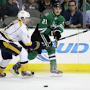Nashville Predators' Ryan Ellis, left, defends as Dallas Stars' Antoine Roussel (21) of France passes the puck to the front of the net allowing Ryan Garbutt to score off the assist from Roussel in the first period of an NHL hockey game, Friday, March 28,