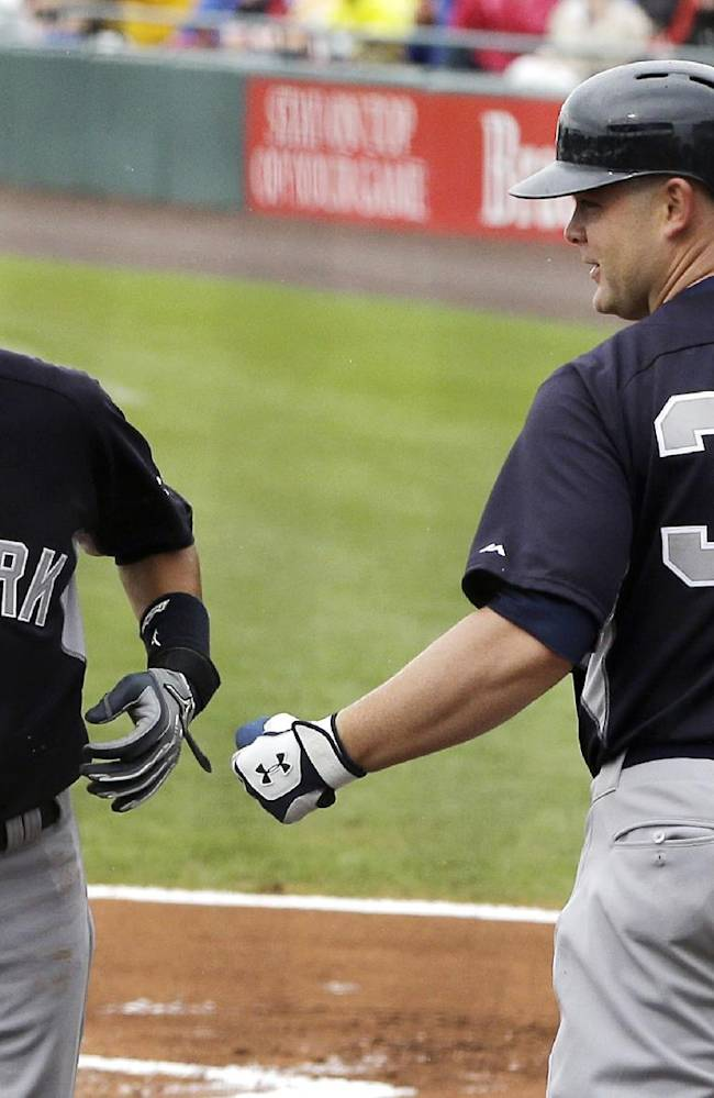 New York Yankees' Ichiro Suzuki, left, is congratulated by Brian McCann after scoring from third as teammate Mark Teixeira's grounds out during the first inning of a spring exhibition baseball game against the Pittsburgh Pirates in Bradenton, Fla., Thursday, March 27, 2014