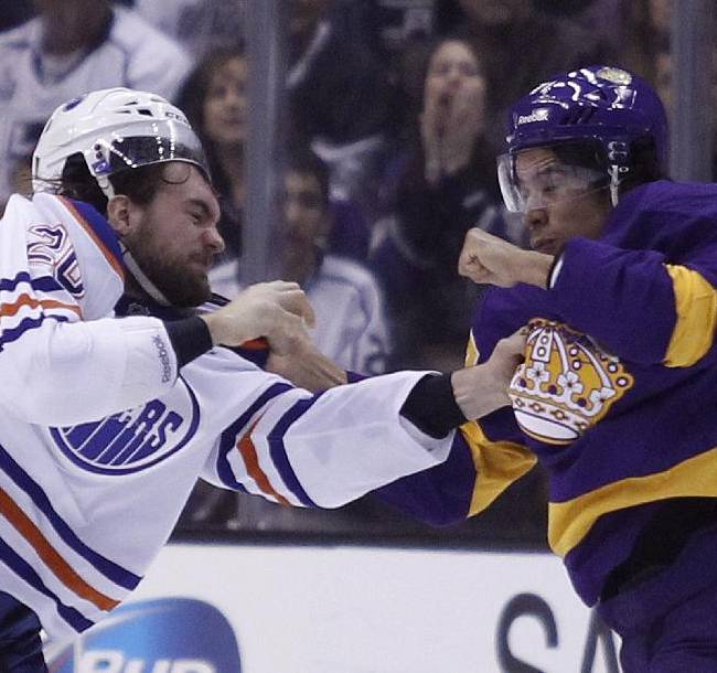 Edmonton Oilers left wing Luke Gazdic, left, scuffles with Los Angeles Kings center Jordan Nolan, right, during the second period of an NHL hockey game Sunday, Oct. 27, 2013, in Los Angeles