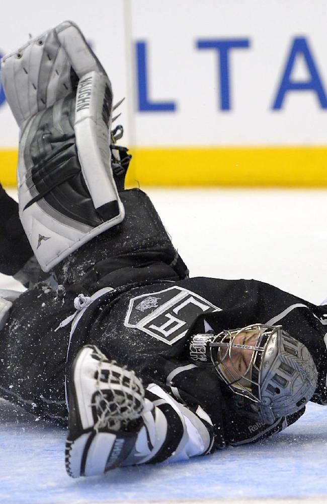 Los Angeles Kings goalie Jonathan Quick is scored on by Detroit Red Wings left wing Tomas Tatar, of Slovenia, during the third period of an NHL hockey game, Saturday, Jan. 11, 2014, in Los Angeles