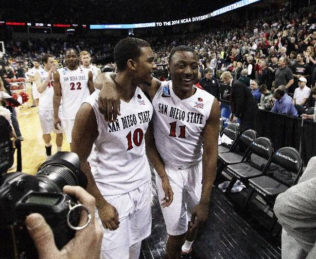 San Diego State's Aqeel Quinn (10) and D'Erryl Williams (11) walk off the court after winning against North Dakota State in the second half during the third-round game of the NCAA men's college basketball tournament in Spokane, Wash., Saturday, March 22, 2014. San Diego State won 63-44
