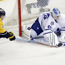 Toronto Maple Leafs goalie Jonathan Bernier (45) and Nashville Predators left wing Taylor Beck (41) reach for the puck in the second period of an NHL hockey game Tuesday, Feb. 3, 2015, in Nashville, Tenn The Associated Press