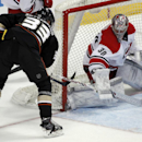 Anaheim Ducks left wing Jakob Silfverberg (33), of Sweden, scores against Carolina Hurricanes goalie Cam Ward (30) during the second period of an NHL hockey game, Sunday, March 2, 2014, in Anaheim, Calif The Associated Press