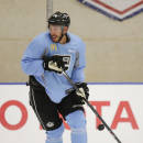 Los Angeles Kings left wing Dwight King controls the puck during NHL hockey training camp Friday, Sept. 19, 2014, in El Segundo, Calif. The Kings went through their first workouts of training camp Friday as they prepare for their run at a third NHL title in four seasons. (AP Photo/Jae C. Hong)