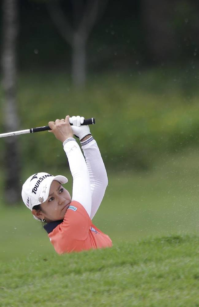 Japan's Ai Miyazato plays from a fairway bunker during her first round at the Malaysian LGPA event in Kuala Lumpur, Thursday, Oct. 10, 2013