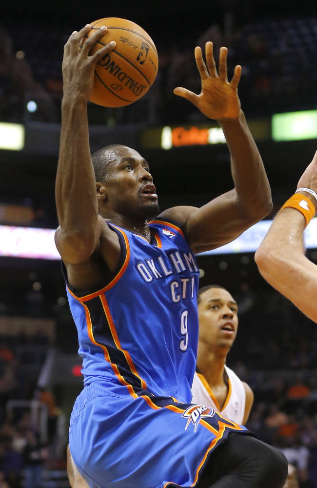Oklahoma Thunder forward Serge Ibaka, of Congo, shoots against the Phoenix Suns during the first half of an NBA preseason basketball game, Tuesday, Oct. 22, 2013, in Phoenix