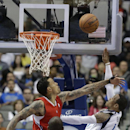 Dallas Mavericks guard Monta Ellis (11) shoots against Los Angeles Clippers forward Matt Barnes during the first half of an NBA basketball game Thursday, March 27, 2014, in Dallas The Associated Press