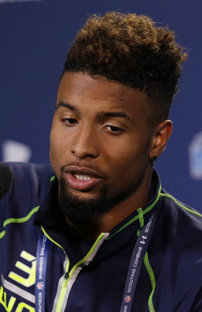 Louisiana State wide receiver Odell Beckham answers a question during a news conference at the NFL football scouting combine in Indianapolis, Friday, Feb. 21, 2014