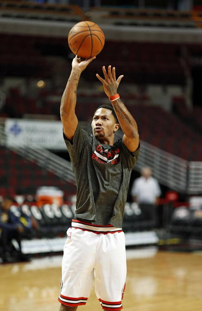 Chicago Bulls guard Derrick Rose shoots before an NBA basketball game against the Utah Jazz in Chicago, Friday, Nov. 8, 2013