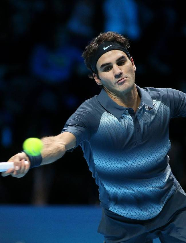 Roger Federer of Switzerland plays a return to Juan Martin Del Potro of Argentina during their ATP World Tour Finals tennis match at the O2 Arena in London, Saturday, Nov. 9, 2013