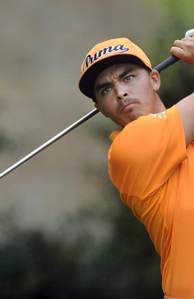 Rickie Fowler hits from the tee on the fourth hole during the final round of play in the Tour Championship golf tournament Sunday, Sept. 14, 2014, in Atlanta
