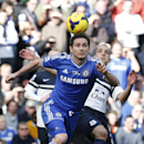 Chelsea's Frank Lampard, left, controls the ball in front of Everton's Leon Osman, right, during an English Premier League soccer match at the Stamford Bridge ground in London, Saturday, Feb. 22, 2014. Chelsea won the match 1-0