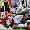 Kansas City Chiefs tight end Anthony Fasano (80) is tackled by Minnesota Vikings defensive tackle Sharrif Floyd (73) and cornerback Captain Munnerlyn (24) during the first half of an NFL preseason football game in Kansas City, Mo., Saturday, Aug. 23, 2014