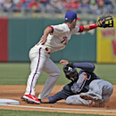 Atlanta Braves' Jason Heyward slides safe into third as Philadelphia Phillies' Jayson Nix waits for the ball in the third inning of a baseball game Thursday, April 17, 2014, in Philadelphia The Associated Press