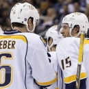 Nashville Predators' Craig Smith, right, celebrates with teammate Shea Weber after scoring his team's fourth goal during the third period of an NHL hockey game, Thursday, Nov. 21, 2013 in Toronto The Associated Press