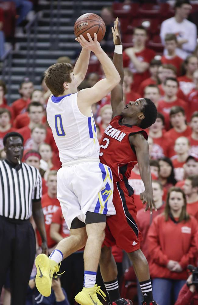Mukwonago's Aaron Nixon (0) shoots over Neenah's Taulvish McCray during the first half of a WIAA Division 1 semifinal basketball game on Friday, March 14, 2014, in Madison, Wis