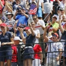 (Front L-R) Jessica Korda, Morgan Pressel and Paula Creamer of Team USA encourage fans on the first tee during the Friday afternoon four-ball matches at the 2013 Solheim Cup at Colorado Golf Club in Parker, Colorado August 16, 2013. REUTERS/Rick Wilking