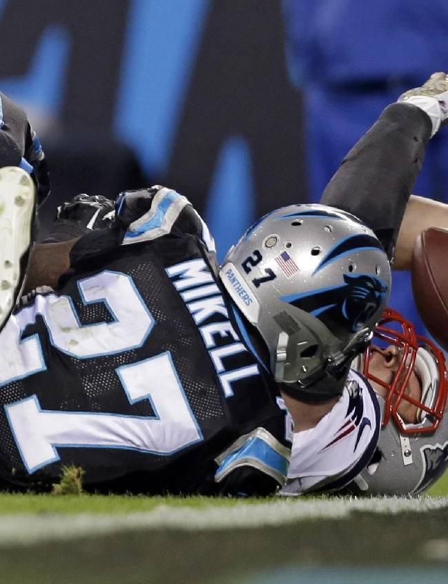 New England Patriots' Rob Gronkowski, right, stretches the ball over the goal line for a touchdown as Carolina Panthers' Quintin Mikell, left, defends during the second half of an NFL football game in Charlotte, N.C., Monday, Nov. 18, 2013