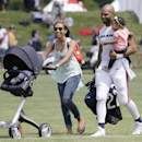 Chicago Bears running back Matt Forte (22), center, leaves the field with his wife Danielle Daniels, left, and his daughter Nahla after NFL football training camp at Olivet Nazarene University, Wednesday, July 30, 2014, in Bourbonnais, Ill The Associated