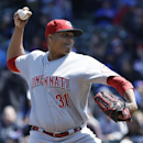 Cincinnati Reds starter Alfredo Simon throws against the Chicago Cubs during the first inning of a baseball game in Chicago, Friday, April 18, 2014 The Associated Press