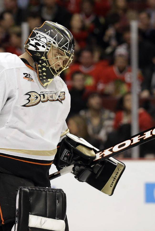 Anaheim Ducks goalie Jonas Hiller looks down as he skates to the bench during the second period of an NHL hockey game against the Chicago Blackhawks in Chicago, Friday, Jan. 17, 2014