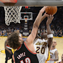 Los Angeles Lakers guard Jodie Meeks, right, puts up a shot as Portland Trail Blazers center Robin Lopez during the second half of an NBA basketball game, Sunday, Dec. 1, 2013, in Los Angeles The Associated Press