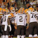 In this Aug. 28, 2014, file photo, Cleveland Browns quarterback Johnny Manziel (2) calls a play in the huddle in the second quarter of a preseason NFL football game against the Chicago Bears in Cleveland. The no-huddle offense has been a part of pro foot