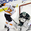 Minnesota Wild goalie Josh Harding, right, stops a shot by Philadelphia Flyers' Wayne Simmonds in the first period of an NHL hockey game, Monday, Dec. 2, 2013, in St. Paul, Minn The Associated Press