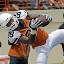 In this April 19, 2014 file photo, University of Texas football player Montrel Meander comes down with a pass during the first half of the Orange and White college football game, in Austin, Texas. A University of Texas police spokeswoman says two Longhorn