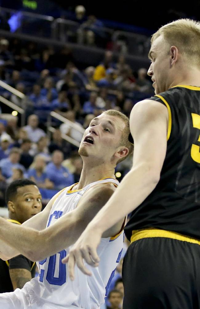 UCLA guard Bryce Alford, left, is fouled by Arizona State forward Jonathan Gilling during the second half of an NCAA college basketball game in Los Angeles, Sunday, Jan. 12, 2014