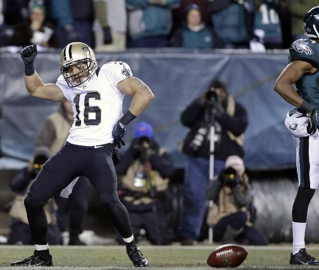 New Orleans Saints' Lance Moore (16) celebrates after scoring a touchdown during the second half of an NFL wild-card playoff football game against the Philadelphia Eagles, Saturday, Jan. 4, 2014, in Philadelphia