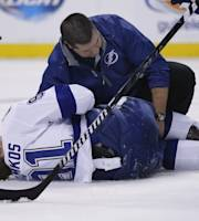 Tampa Bay Lightning center Steven Stamkos is attended to on the ice after banging into the goalpost during the second period of an NHL hockey game against the Boston Bruins in Boston Monday, Nov. 11, 2013. Stamkos was taken off the ice on a stretcher after the play. (AP Photo/Elise Amendola)