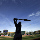 Kansas City Royals shortstop Pedro Ciriaco takes a swing while waiting to bat against the Arizona Diamondbacks during the sixth inning of an exhibition spring training baseball game Wednesday, March 5, 2014, in Scottsdale, Ariz The Associated Press